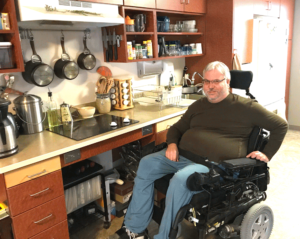 man in wheelchair, accessible kitchen, adeo housing, hope apartments