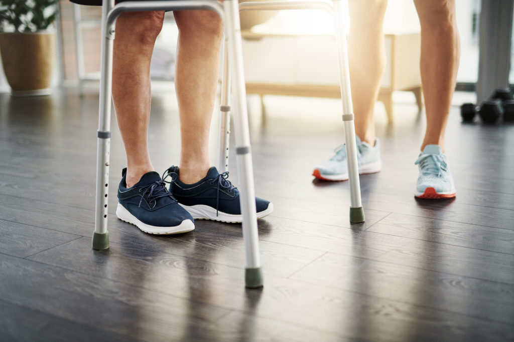 man walking with assistance, balance and gait disorders