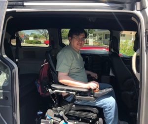 man in wheelchair inside accessible van at stephens farm. Adeo Brain Injury Services