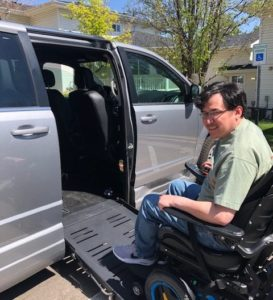 man using accessible wheelchair ramp into van at stephens farm. Adeo Brain Injury Services