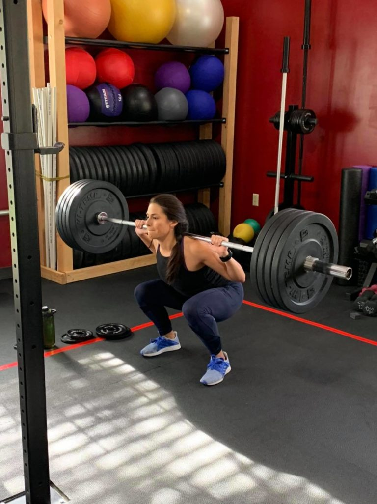 woman squatting with weights, Total Fit Class