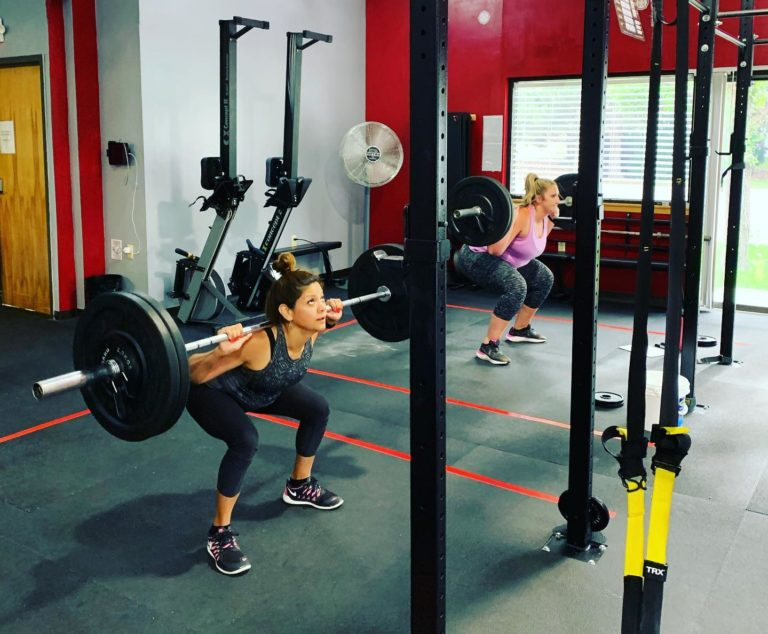 woman squatting with weights