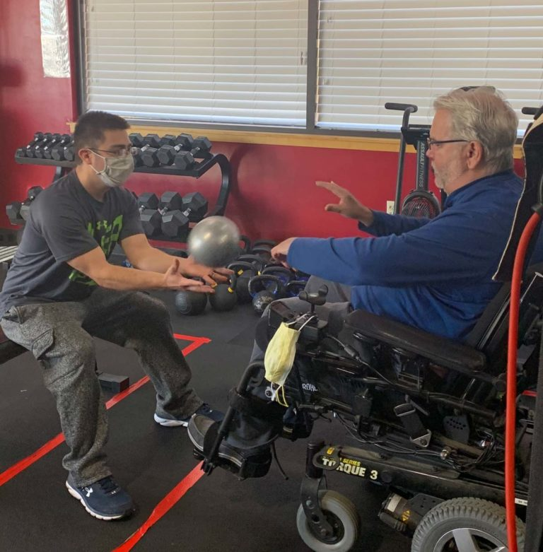 man in wheelchair exercising, adaptive fitness, inclusion, functional fitness